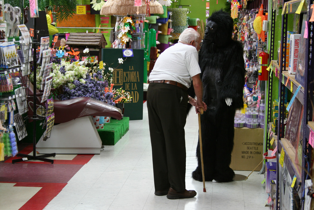 Man smelling gorilla suit